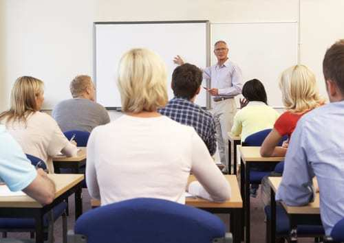 classroom of adult students learning from teacher