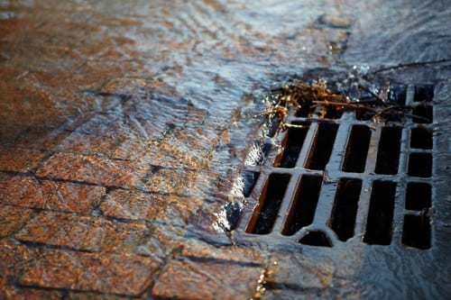 stormwater flows into manhole cover