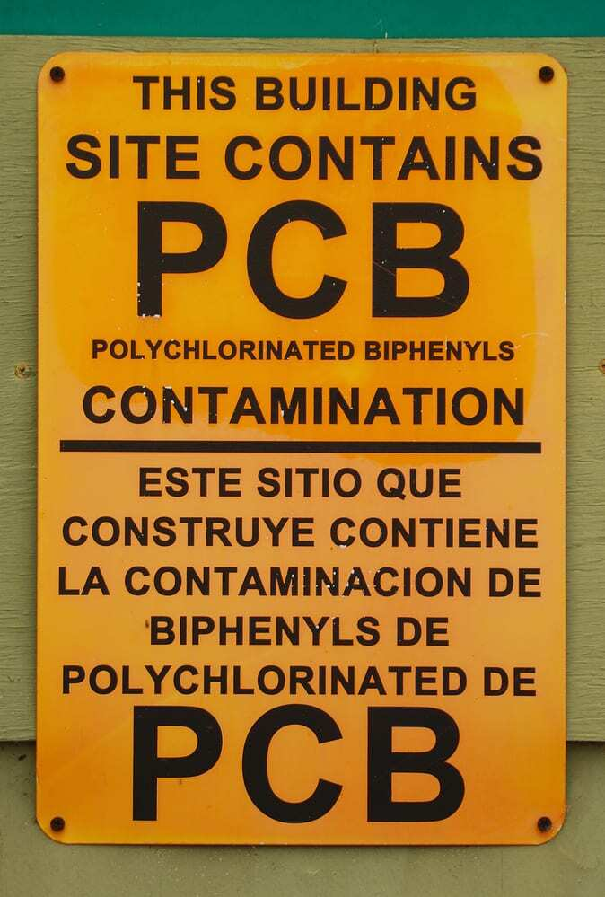 PCB Alert Sign in English and Spanish