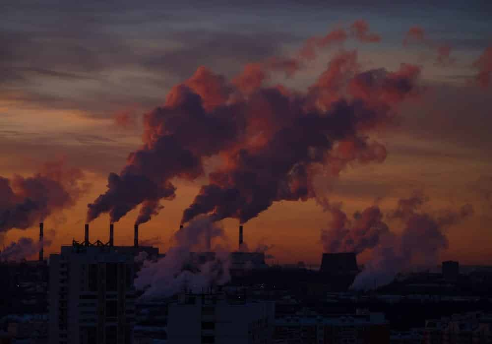 Sunset Heavy smoke discharged by industrial complex, pollution