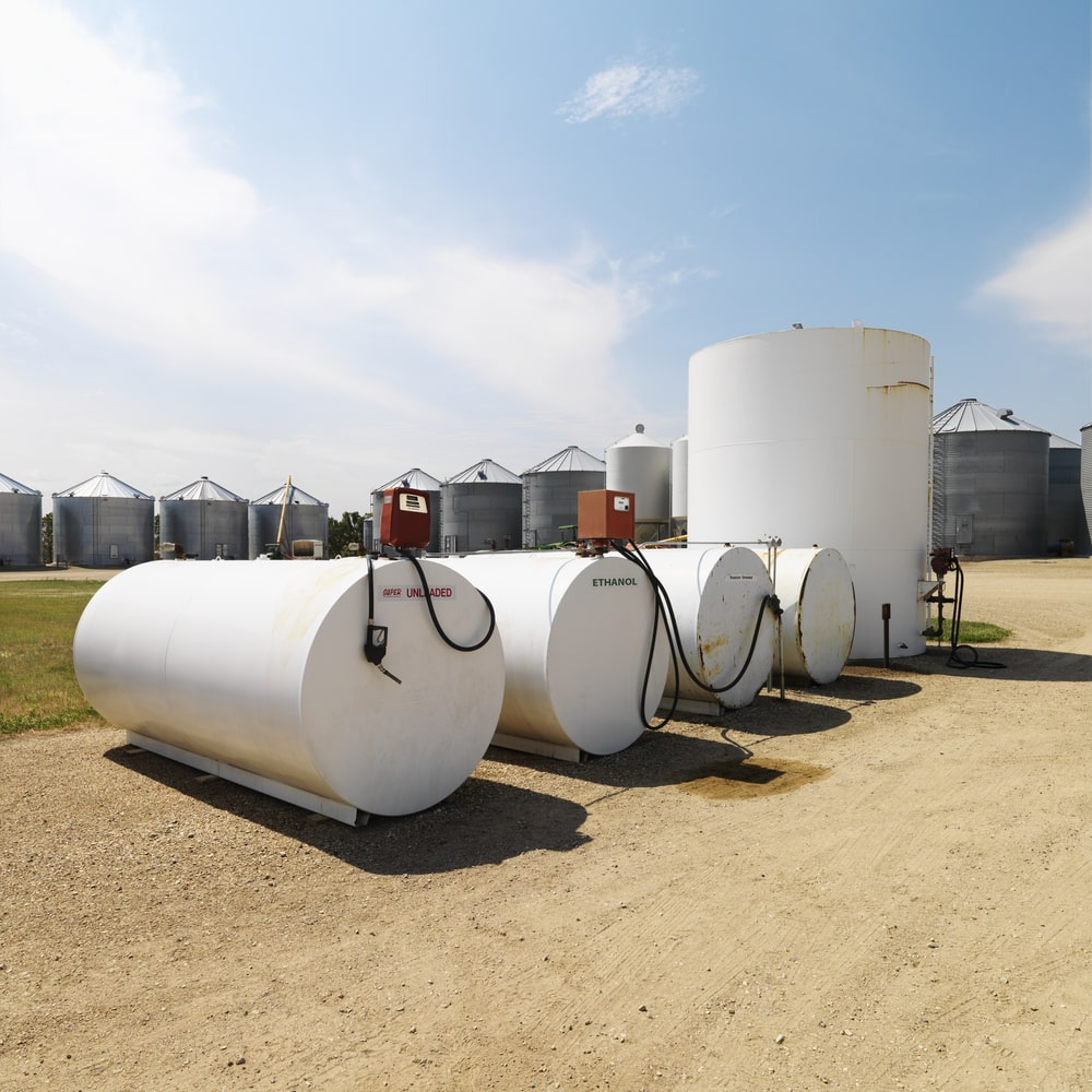 Several white fuel tanks and pumps